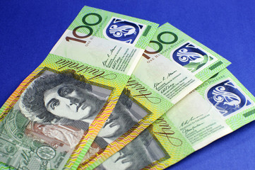Three hundred Australian dollar notes on blue background.