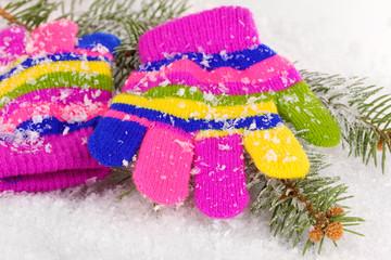 Children's mittens in snow