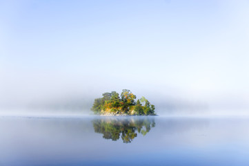 small island in foggy morning