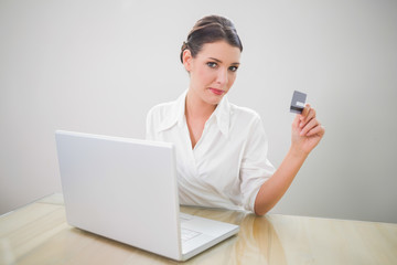 Content pretty businesswoman shopping online using laptop