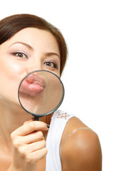attractive young woman give kiss through a magnifying glass over