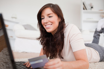 Young charming female making a payment