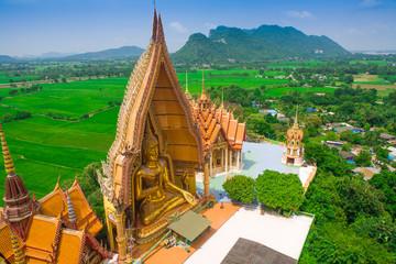 Big golden Buddha in temple, Kanchanaburi Thailand