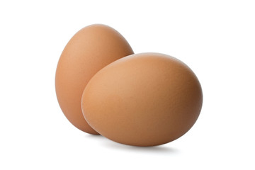 Two Chicken Brown eggs on white background