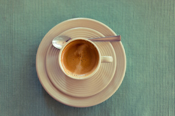 Cup of espresso on a green napkin