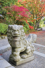 Japanese Komainu Male Foo Dog Sculpture in Fall Season