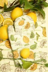 Oven mitt and lemons