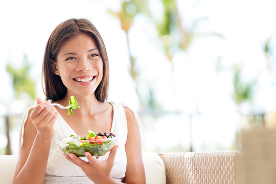 Healthy lifestyle woman eating salad smiling happy
