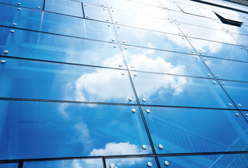 Modern business building with sky reflection