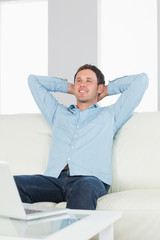 Handsome casual man relaxing with crossed arms