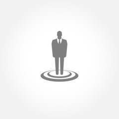 Businessman standing on the target - vector icon