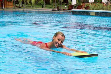 Swimmer during practice with board from polyfoam for swimming