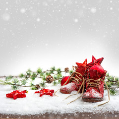 nostalgic christmas decoration with antique baby shoe
