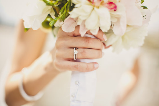 Bride's hands with flowers