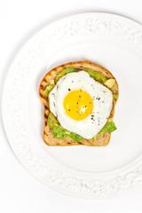 Healthy Breakfast. Egg and Avocado Toast