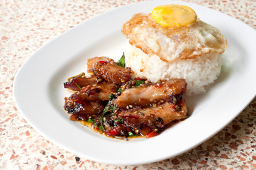 Rice with stir fried hot and spicy pork with basil