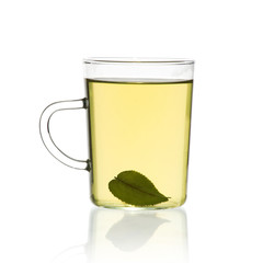 Cup of green tea with green tea leaf