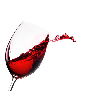 Glass of wine with splash