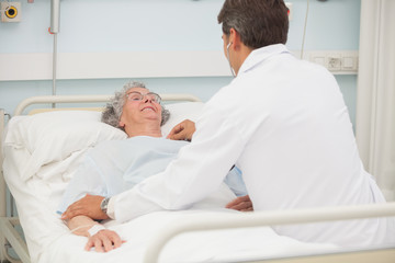 Doctor caring about elderly lady