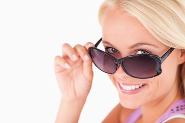 Cute lady peeking over her sunglasses