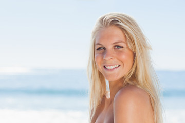 Close up view of blonde woman smiling at camera