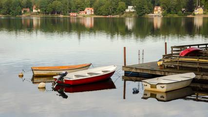 Three boats at wooden pier