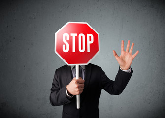Wall Mural - Businessman holding a stop sign