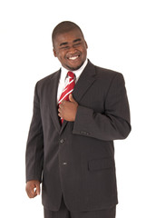 Handsome African American model in business suit and red tie