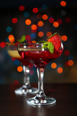 Two cocktails with fresh berries,on bright background
