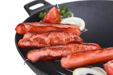 Delicious sausages in wok isolated on white