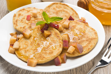 homemade pancakes with peaches and honey for breakfast