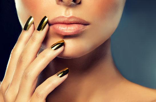 Golden makeup and metal gold nails