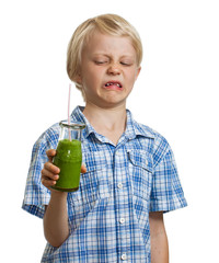 Funny boy unhappy about green smoothie