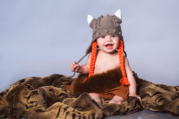 Little baby in viking style hat