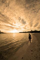 Female Silhouette on Romantic Beach at Sunset
