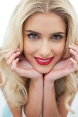 Close up of a smiling blonde model looking at camera