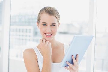 Cheerful sporty woman using tablet computer