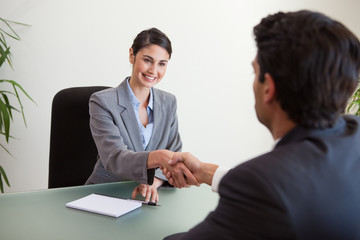 Manager shaking the hand of a customer