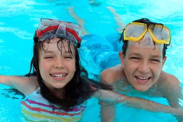 Happy kids swimming