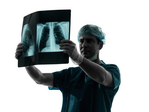 doctor surgeon radiologist examining lung torso  x-ray image