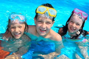 Smiling children in swimming pool