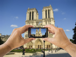 taking a picture  of Notre Dame
