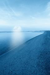moon on the sea on the shoreline