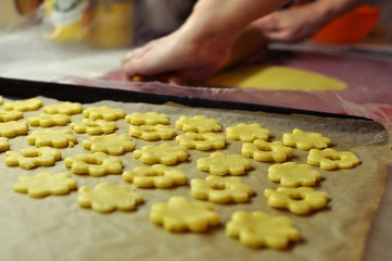 Baking of traditional Christmas cookies in a kitchen