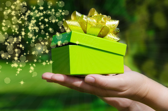 Green Gift box in woman's hands