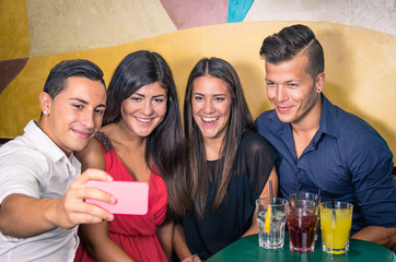 Group of friends taking a photo with smartphone