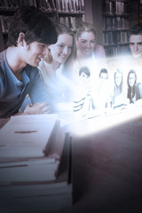 Cheerful college friends watching photos on futuristic interface