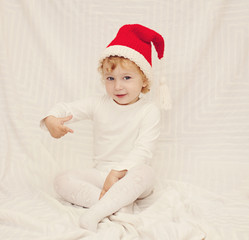 Cute little girl in red christmas hat