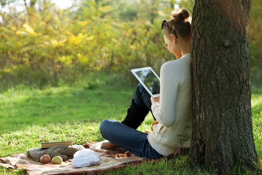 Distance education. Sitting woman using ipad
