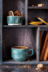 Coffee and spices on a vintage wooden background